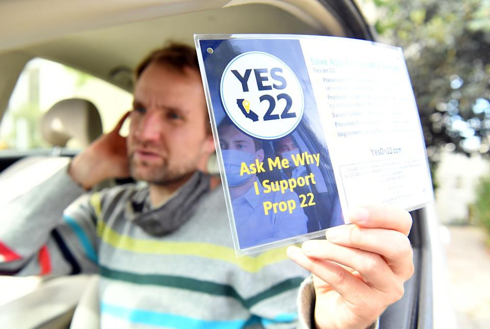 """Uber driver Sergei Fyodorov discusses why he supports a yes vote on Proposition 22 in Oakland, California on October 9, 2020. - Ahead of a referendum that could upend the whole gig economy, Uber driver Karim Benkanoun says his relationship with the rideshare giant must stop being a one-way street. """"If youre a driver with Uber or Lyft, you're nothing,"""" said Benkanoun as he speaks of how he will vote in California's Proposition 22 referendum. (Photo by JOSH EDELSON / AFP) (Photo by JOSH EDELSON/AFP via Getty Images)"""