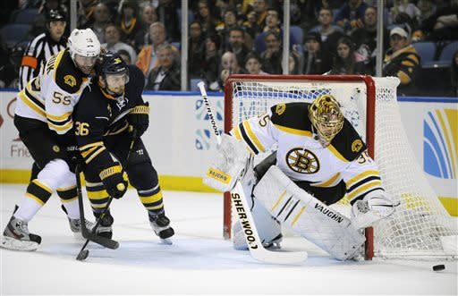 Buffalo Sabres' right winger Patrick Kaleta (36) battles for the puck while Boston Bruins' defenseman Johnny Boychuk (55) and goaltender Anton Khudobin (35), of Kazakhstan, defends during the first period of an NHL hockey game in Buffalo, N.Y., Sunday, March 31, 2013. (AP Photo/Gary Wiepert)