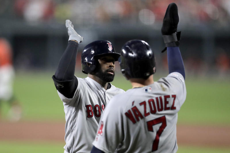 Boston Red Sox's Jackie Bradley Jr. is greeted at home plate by Christian Vazquez (7) after Bradley Jr. hit a three run home run off Baltimore Orioles relief pitcher Jimmy Yacabonis during the fourth inning of a baseball game, Saturday, July 20, 2019, in Baltimore. (AP Photo/Julio Cortez)