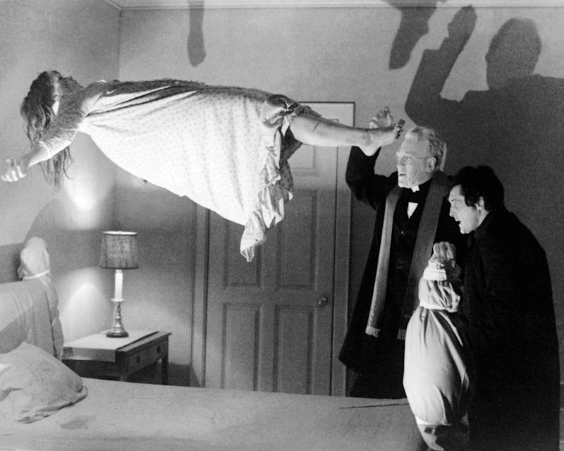 Left to right: Linda Blair as Regan MacNeil, Max von Sydow as Father Merrin, and Jason Miller (1939 - 2001) as Father Karras in 'The Exorcist', directed by William Friedkin, 1973. (Photo by Silver Screen Collection/Getty Images)