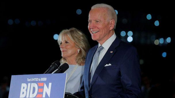 PHOTO: Democratic presidential candidate and former Vice President Joe Biden smiles as he speaks with his wife Jill at his side during a primary night news conference at The National Constitution Center in Philadelphia, March 10, 2020. (Brendan Mcdermid/Reuters)
