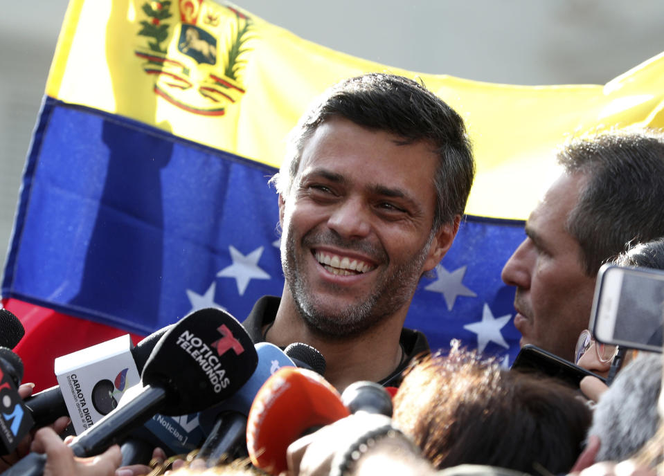 FILE - In this May 2, 2019 file photo, Venezuelan opposition leader Leopoldo Lopez smiles during a press conference at the gate of the Spanish ambassador's residence in Caracas, Venezuela. Lopez left the residence where he had been a guest since April 30, 2019 and is leaving Venezuela people close to the opposition leader said on Saturday, Oct. 24, 2020. (AP Photo/Martin Mejia, File)