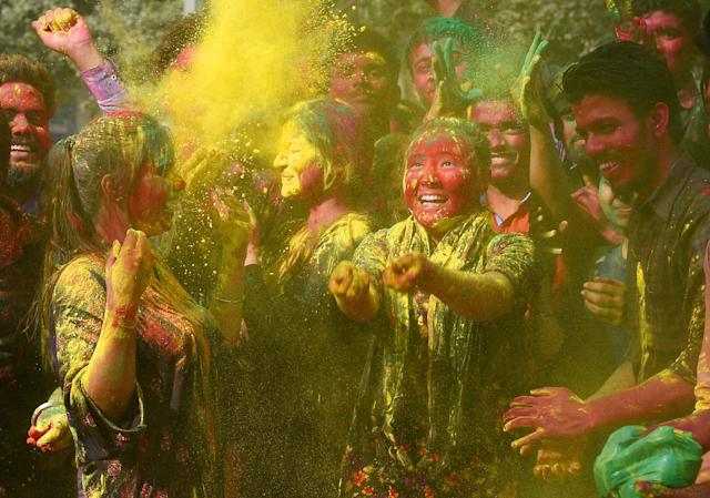 <p>Students celebrate the Holi festival on March 1, 2018 in New Delhi, India. (Photo: Raj K. Raj/Hindustan Times via Getty Images) </p>