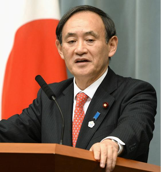 """Japan's chief Cabinet spokesman Yoshihide Suga speaks about North Korea during a regular press conference at the Prime Minister's official residence in Tokyo Monday, April 8, 2013. On Monday, amid reports North Korea is preparing a missile launch or another nuclear test, Japanese officials said they have stepped up measures to ensure the nation's safety. """"We are doing all we can to protect the safety of our nation,"""" said Suga, though he and defense ministry officials refused to confirm the reports about the naval alert, saying they do not want to """"show their cards"""" to North Korea. (AP Photo/Kyodo News) JAPAN OUT, MANDATORY CREDIT, NO LICENSING IN CHINA, HONG KONG, JAPAN, SOUTH KOREA AND FRANCE"""
