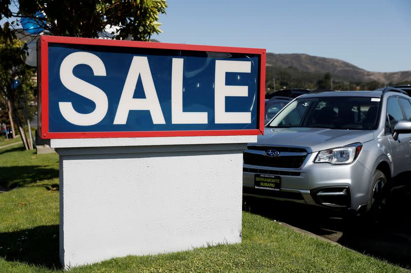 FILE PHOTO: A sale sign is seen at car dealer Serramonte Subaru in Colma, California