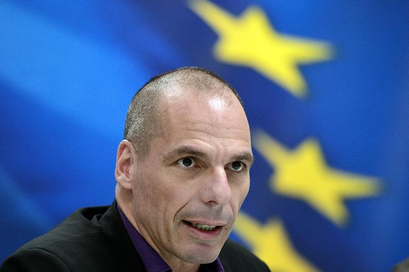 Greek Finance Minister Yanis Varoufakis arrives to present his ministry's new secretaries at a press conference in Athens on March 4, 2015