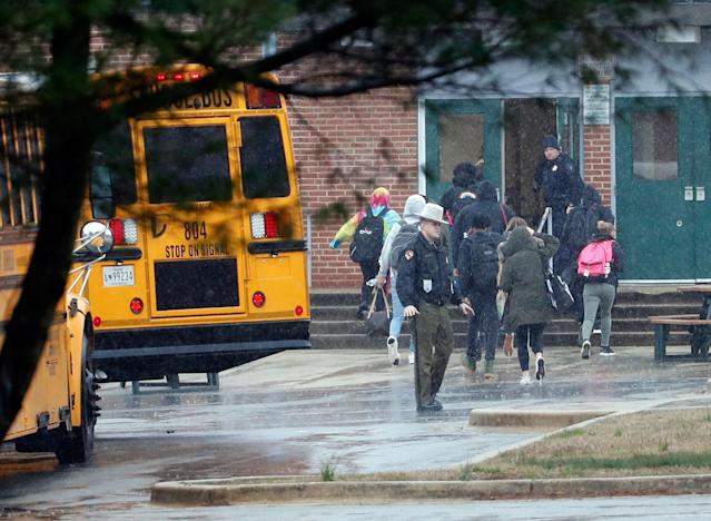 <p>Police move students into a different area of Great Mills High School, the scene of a shooting, Tuesday morning, March 20, 2018 in Great Mills, Md. (Photo: Alex Brandon/AP) </p>