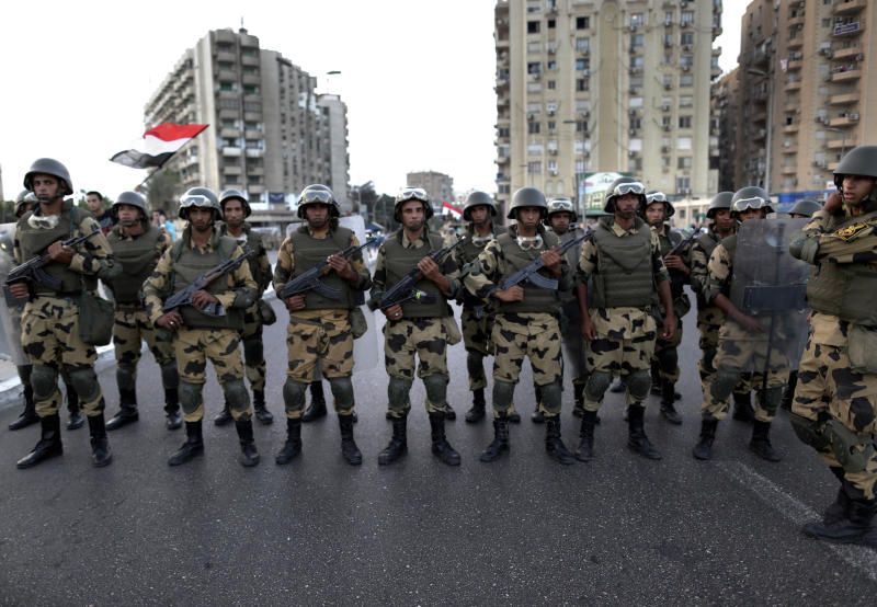 Military special forces surround supporters of Islamist leader Mohammed Morsi in Nasser City, Cairo, Egypt, Wednesday, July 3, 2013. Army troops backed by armor and including commandos have deployed across much of the Egyptian capital, near protest sites and at key facilities and major intersections. The deployment is part of a bid by the military to tighten its control of key institutions Wednesday, slapping a travel ban on embattled president Mohammed Morsi and top allies in preparation for an almost certain push to remove the Islamist president with the expiration of an afternoon deadline. (AP Photo/Hassan Ammar)