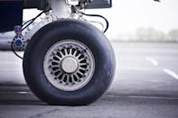 "The real reason airplane tires rarely pop, even though they're carrying a huge amount of weight? It's not their just thickness that contributes to their strength under pressure. According to a <a href=""https://www.wired.com/2016/08/airplane-tires/"" rel=""nofollow noopener"" target=""_blank"" data-ylk=""slk:Wired"" class=""link rapid-noclick-resp""><em>Wired</em></a> report, airplane tires are pumped to roughly 200 psi—about six times the psi of an average car tire. In fact, according to an experiment recorded by <a href=""https://www.youtube.com/watch?v=1TWAR1KtYJU"" rel=""nofollow noopener"" target=""_blank"" data-ylk=""slk:National Geographic"" class=""link rapid-noclick-resp""><em>National Geographic</em></a>, a Boeing 737's tires can withstand over 900 psi before bursting."
