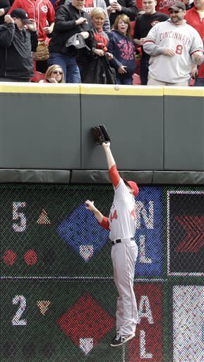 Los Angeles Angels left fielder Mark Trumbo can't reach a double hit off the top of the wall by Cincinnati Reds' Todd Frazier in the fourth inning of an interleague baseball game, Thursday, April 4, 2013, in Cincinnati. (AP Photo/Al Behrman)