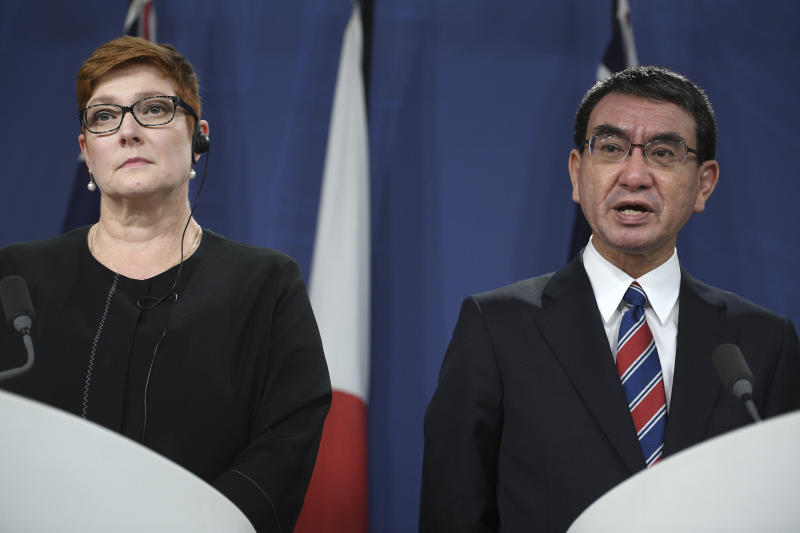 Japanese Foreign Minister Taro Kono, right, speaks as Australian Foreign Minister Marise Payne listens during a joint press conference in Sydney, Wednesday, Oct. 10, 2018. Australia and Japan on Wednesday reaffirmed their commitment to pressuring North Korea to abandon its nuclear weapons program and enforcing sanctions on Pyongyang. (Dan Himbrechts/AAP Images via AP)