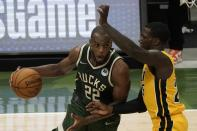 Milwaukee Bucks' Khris Middleton drives past Miami Heat's Kendrick Nunn during the second half of Game 1 of their NBA basketball first-round playoff series Saturday, May 22, 2021, in Milwaukee. (AP Photo/Morry Gash)