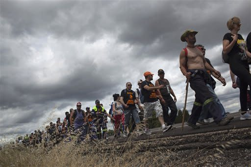 Coal miners walk along a motorway during a protest march near Leon, Spain, Thursday, June 14, 2012. Strikes, road blockades, and mine sit-ins continue as 8,000 mineworkers at over 40 coal mines in northern Spain continue their protests against government action to cut coal subsidies. (AP Photo/Emilio Morenatti)
