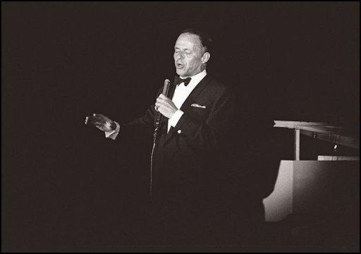 Legendary US singer Frank Sinatra performs on stage at the Lido Theater in Paris in 1962