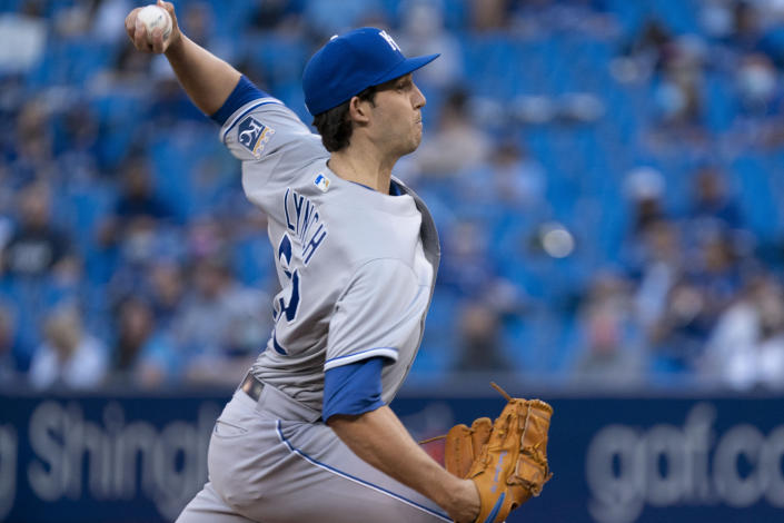Kansas City Royals pitcher Daniel Lynch throws to a Toronto Blue Jays batter during the first inning of a baseball game Friday, July 30, 2021, in Toronto. The Blue Jays were playing in Toronto for the first time since the COVID-19 pandemic began. (Peter Power/The Canadian Press via AP)