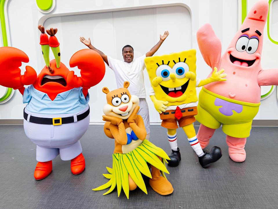 <p>Tracy Morgan wishes SpongeBob SquarePants a happy birthday at the Nickelodeon Universe Theme Park at American Dream in New Jersey.</p>
