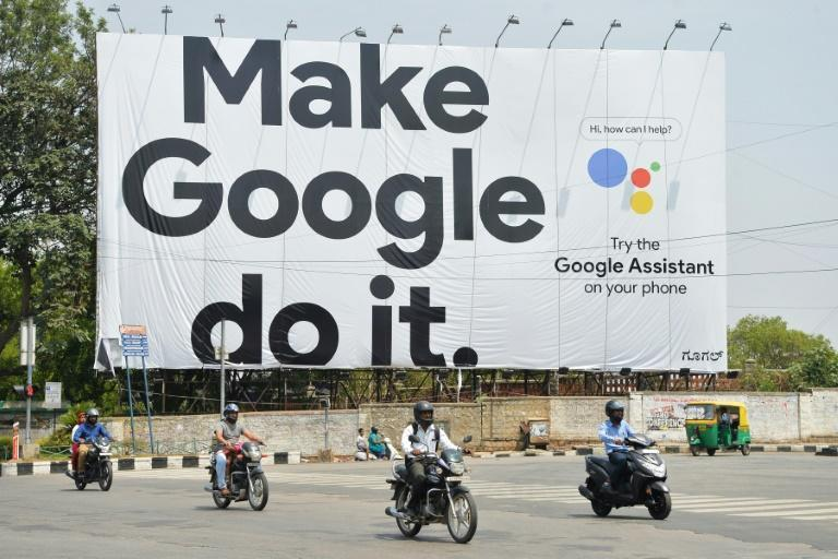 Google is among the global tech giants vying for a share of India's massive market (AFP Photo/MANJUNATH KIRAN)
