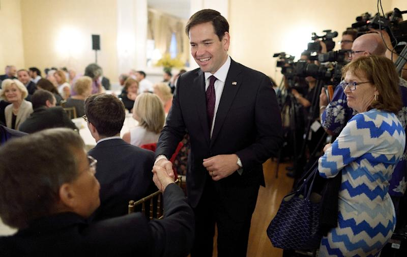 Senator Marco Rubio shakes hands as he leaves the Foreign Policy Initiative breakfast on August 14, 2015 in New York (AFP Photo/Don Emmert)