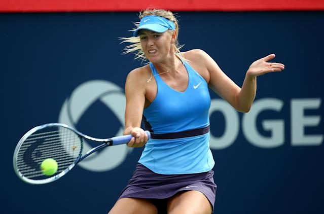 Maria Sharapova returns a shot to Garbine Muguruza during their Rogers Cup match in Montreal on August 6, 2014 (AFP Photo/Streeter Lecka)