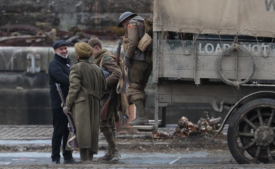 Director Sam Mendes (left) thanks cast members on the set of his new film 1917 at Govan Docks in Glasgow. (Photo by Andrew Milligan/PA Images via Getty Images)