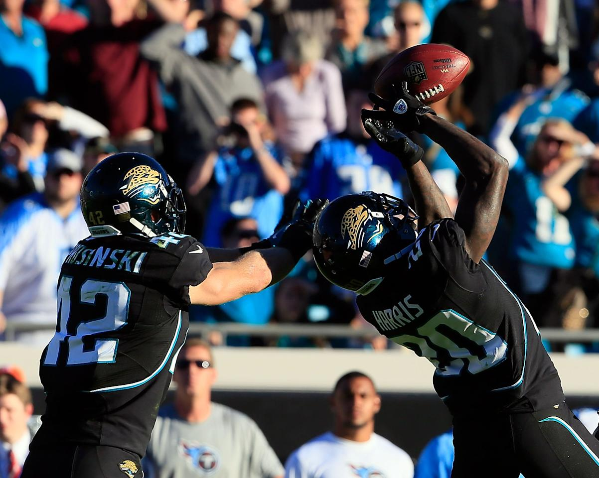 JACKSONVILLE, FL - NOVEMBER 25:  Mike Harris #20 of the Jacksonville Jaguars makes an interception during the game against the Tennessee Titans at EverBank Field on November 25, 2012 in Jacksonville, Florida.  (Photo by Sam Greenwood/Getty Images)