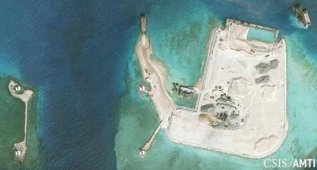 Center for Strategic and International Studies (CSIS) Asia Maritime Transparency Initiative image of the artificial island at the southern end of Mischief Reef showing a newly-built seawall on its north side and a completed dock