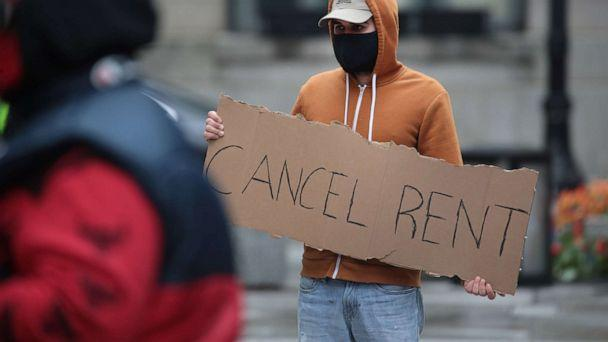 PHOTO: A demonstrator calls on the governor to suspend rent and mortgage payments to help those who have lost their income due to the coronavirus during a protest, April 30, 2020, in Chicago. (Scott Olson/Getty Images)