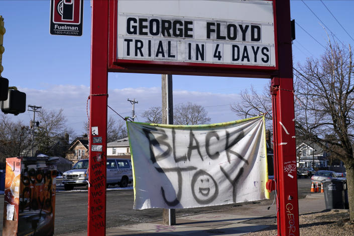 A trial countdown sign marks the days at George Floyd Square, March 4, 2021, in Minneapolis. Ten months after police officers brushed off George Floyd's moans for help on the street outside a south Minneapolis grocery, the square remains a makeshift memorial for Floyd who died at the hand of police making an arrest. The trial of former Minneapolis police officer Derek Chauvin will begin with jury selection on March 8. (AP Photo/Jim Mone)