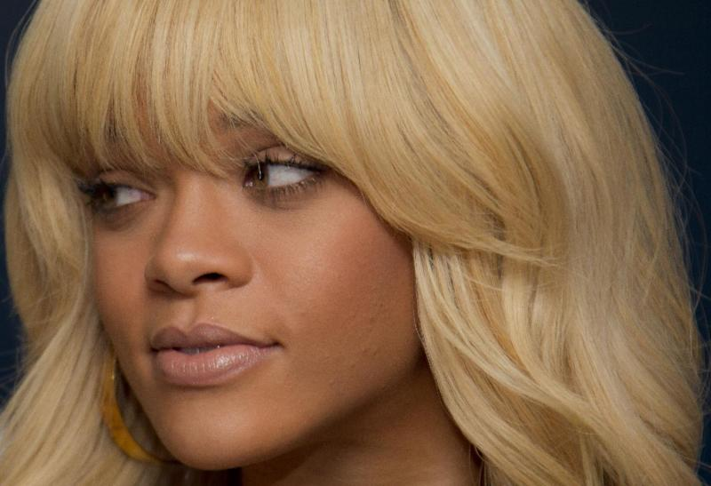 Rihanna poses for photographers at a central London hotel during a photocall for the film 'Battleship', Wednesday, March 28, 2012. (AP Photo/Joel Ryan)