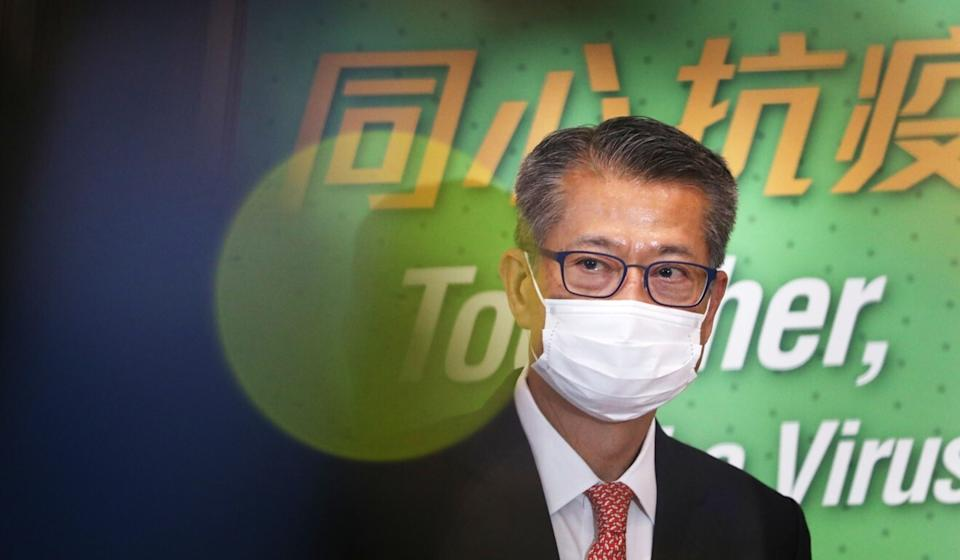 Financial Secretary Paul Chan meets the press on Monday to discuss efforts to boost consumption. Photo: May Tse