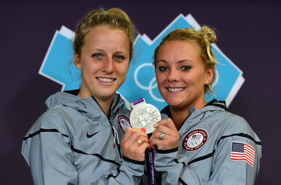 """<a href=""""http://sports.yahoo.com/olympics/diving/abigail-johnston-1132250/"""" data-ylk=""""slk:Abigail Johnston"""" class=""""link rapid-noclick-resp"""">Abigail Johnston</a> and <a href=""""http://sports.yahoo.com/olympics/diving/kelci-bryant-1133362/"""" data-ylk=""""slk:Kelci Bryant"""" class=""""link rapid-noclick-resp"""">Kelci Bryant</a> of the United States pose with their silver medal at a press conference at the Main Press Center after the Women's Synchronised 3m Springboard final on Day two of the London 2012 Olympic Games on July 29, 2012 in London, England. (Photo by Lars Baron/Getty Images)"""