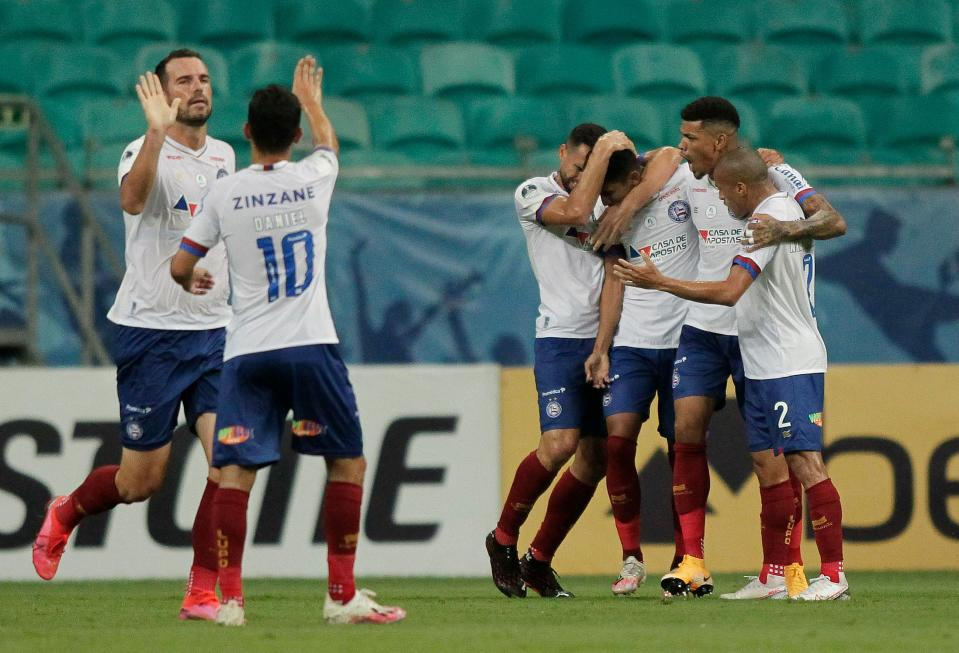 Brazil's Bahia Fessin (3-R) celebrates with teammates after scoring against Peru's Melgar during their closed-door Copa Sudamericana second round football match at the Fonte Nova Arena in Salvador, Brazil, on November 5, 2020, amid the COVID-19 novel coronavirus pandemic. (Photo by Arisson MARINHO / AFP) (Photo by ARISSON MARINHO/AFP via Getty Images)