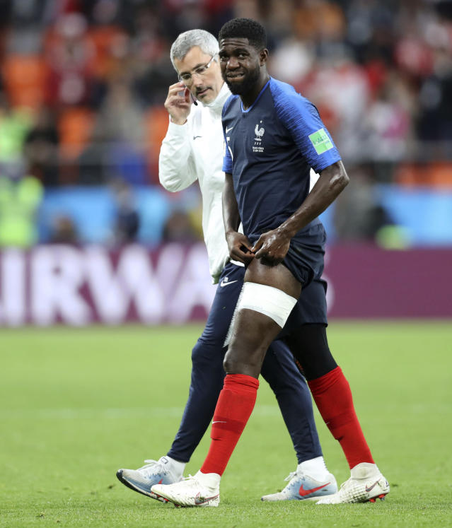 France's Samuel Umtiti walks off the pitch with a member of the French staff after being injured during the group C match between France and Peru at the 2018 soccer World Cup in the Yekaterinburg Arena in Yekaterinburg, Russia, Thursday, June 21, 2018. (AP Photo/David Vincent)