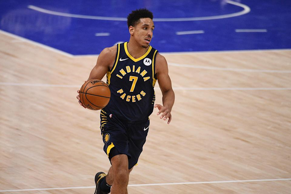 Feb 11, 2021; Detroit, Michigan, USA; Indiana Pacers guard Malcolm Brogdon (7) brings the ball up court against the Detroit Pistons during the third quarter at Little Caesars Arena.