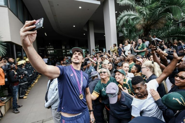All smiles: Eben Etzebeth takes a selfie with supporters as the World Cup winners paraded in Durban earlier this month