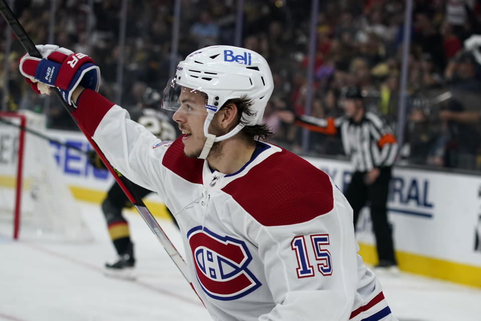 FILE - In this June 22, 2021, file photo, Montreal Canadiens center Jesperi Kotkaniemi (15) celebrates his goal against the Vegas Golden Knights during the first period in Game 5 of an NHL hockey Stanley Cup semifinal playoff series in Las Vegas. The Carolina Hurricanes have tendered an offer sheet to Canadiens restricted free agent Kotkaniemi. It's a one-year deal worth $6.1 million. The Canadiens have seven days to match or receive a first- and a third-round pick as compensation. (AP Photo/John Locher, File)