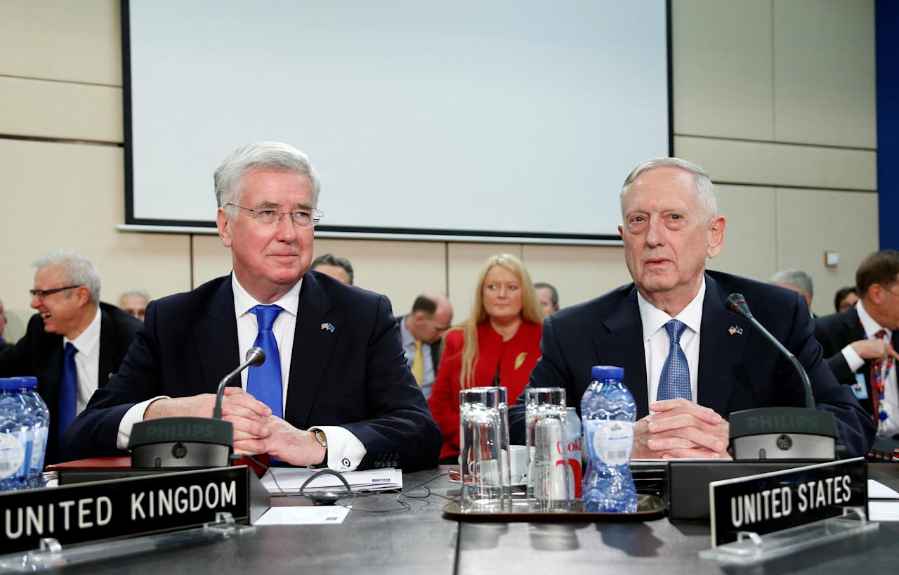 British Defence Secretary Michael Fallon and U.S. Defense Secretary Jim Mattis (R) attend a NATO defence ministers meeting at the Alliance headquarters in Brussels, Belgium, February 15, 2017. REUTERS/Francois Lenoir