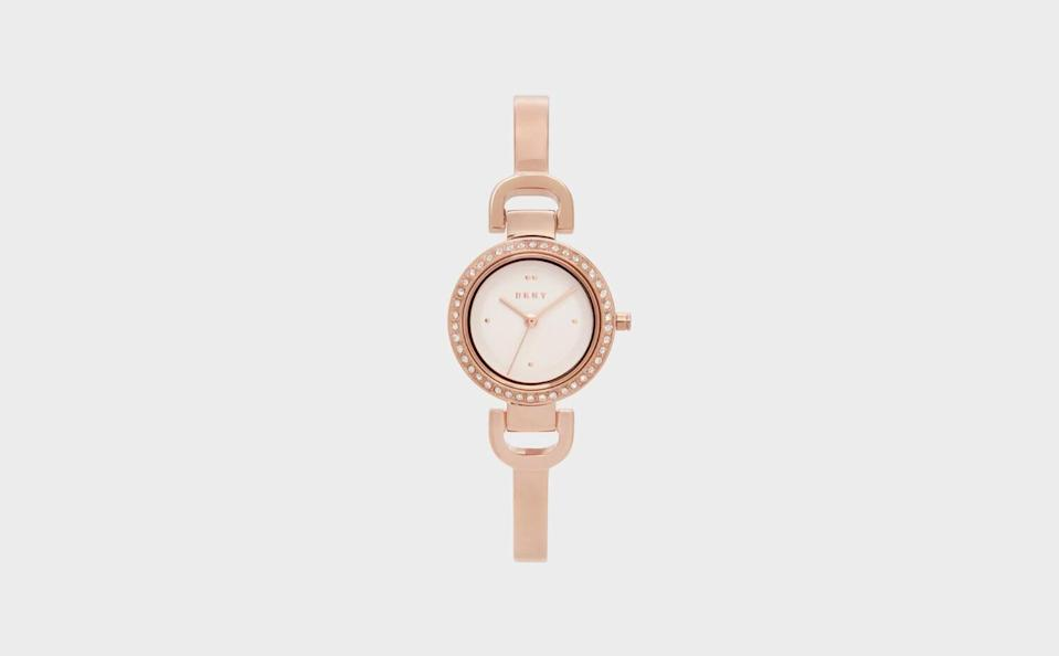 """<p><strong>DKNY</strong></p><p>donnakaran.com</p><p><strong>$155.00</strong></p><p><a href=""""https://go.redirectingat.com?id=74968X1596630&url=https%3A%2F%2Fwww.donnakaran.com%2Fproduct%2Fny2890%2Bcity%2Blink%2Bwatch%2Bbracelet%2Brose%2Bgold.do%3Fsortby%3DourPicks%26from%3DSearch%26selectedOption%3D573943&sref=https%3A%2F%2Fwww.seventeen.com%2Flife%2Ffriends-family%2Fg30140775%2Fgifts-for-mom-from-daughter%2F"""" rel=""""nofollow noopener"""" target=""""_blank"""" data-ylk=""""slk:Shop Now"""" class=""""link rapid-noclick-resp"""">Shop Now</a></p><p>In my house, it's tradition to gift mom a watch every year for the holidays. Speaking from personal experience, yours will love one too. </p>"""