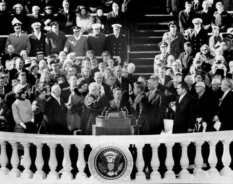 The Inaugural's most solemn moment occurs as Earl Warren, Chief Justice of United States, administers oath of office to John Fitzgerald Kennedy, thereby elevating him to presidency. (Photo by Charles Hoff/NY Daily News Archive via Getty Images)