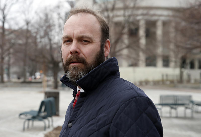 FILE - in this Feb. 14, 2018, file photo, Rick Gates departs Federal District Court in Washington. In a dramatic escalation of pressure and stakes, special counsel Robert Mueller filed additional criminal charges Thursday against President Donald Trump's former campaign chairman Paul Manafort and his business associate, Gates. (AP Photo/Alex Brandon, File)