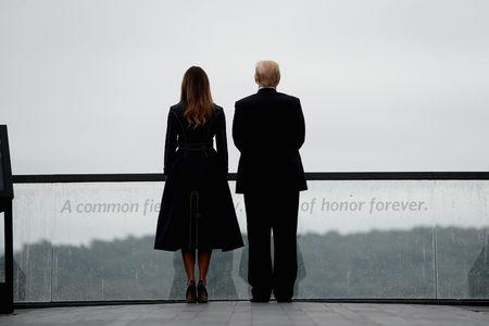 U.S. President Donald Trump and first lady Melania Trump stand together at the Flight 93 National Memorial during the 17th annual September 11 observance at the memorial near Shanksville, Pennsylvania, U.S., September 11, 2018. REUTERS/Kevin Lamarque