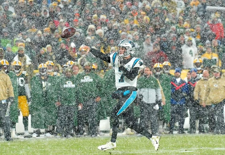 Carolina Panthers quarterback Kyle Allen passes to a receiver as he scrambles out of the pocket during fourth quarter action against the Green Bay Packers on Sunday, November 10, 2019. The Packers defeated the Carolina Panthers 24-16 at Lambeau Field in Green Bay, WI.
