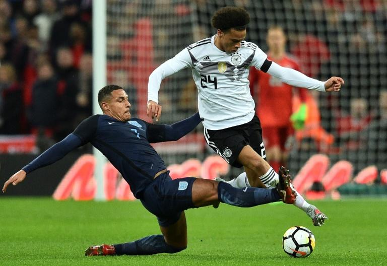 England's midfielder Jake Livermore (L) tries to tackle Germany's midfielder Leroy Sane (R) during their match at Wembley Stadium in London on November 10, 2017