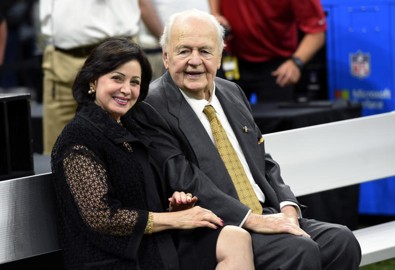FILE - In this Sept. 17, 2017, file photo, New Orleans Saints owner Tom Benson sits on the sideline with his wife, Gayle Benson, before an NFL football game in New Orleans. Attorneys for several men suing the Roman Catholic church say documents they obtained through discovery show that the New Orleans Saints team aided the Archdiocese of New Orleans in its pattern and practice of concealing its crimes. (AP Photo/Bill Feig, File)