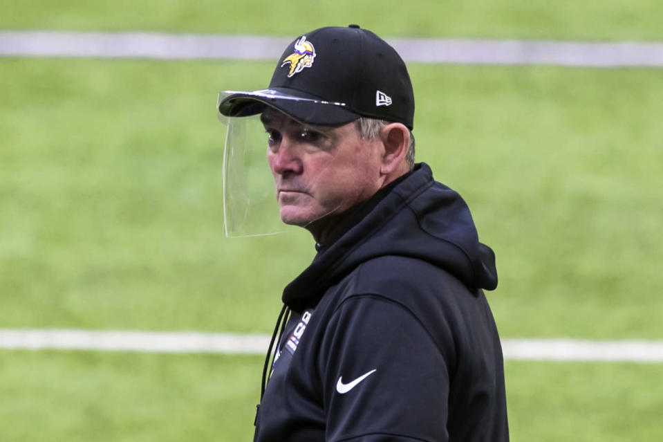 FILE - Minnesota Vikings head coach Mike Zimmer looks on before the start of an NFL football game against the Atlanta Falcons in Minneapolis, in this Sunday, Oct. 18, 2020, file photo. As coach Zimmer prepares for his eighth season with the Vikings, he might need to hire yet another offensive coordinator with Gary Kubiak uncertain to return. (AP Photo/David Berding, File)