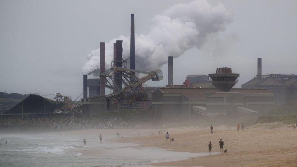Coal station at Port Kembla billowing carbon pollution out onto the beach