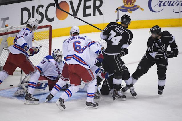 Los Angeles Kings right wing Justin Williams, right, watches as the puck enters the net, left, for a goal against the New York Rangers during the first period in Game 5 of the NHL Stanley Cup Final series Friday, June 13, 2014, in Los Angeles. (AP Photo/Mark J. Terrill)