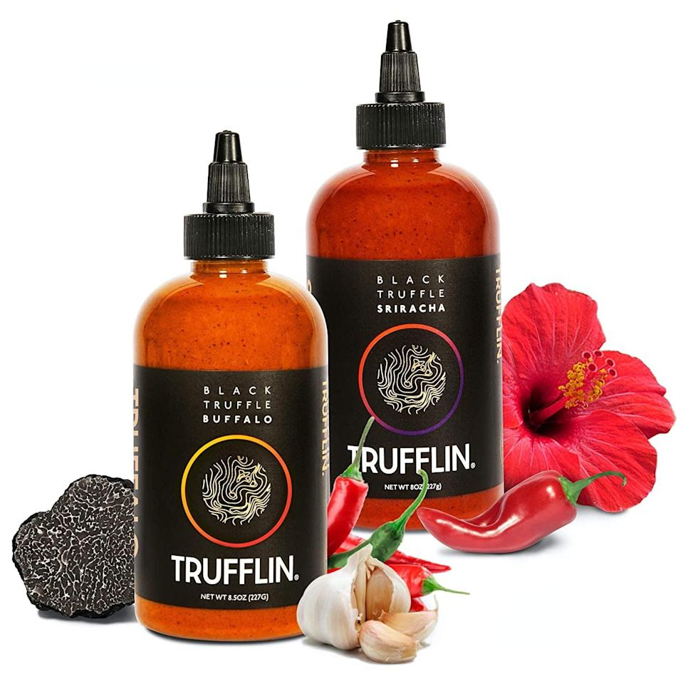 <p>Bring the heat with the gourmet <span>TRUFFLIN Sriracha Hot Sauce and Spicy Buffalo Sauce 2-Pack Bundle</span> ($35) made with real black truffle and ripe chili peppers.</p>