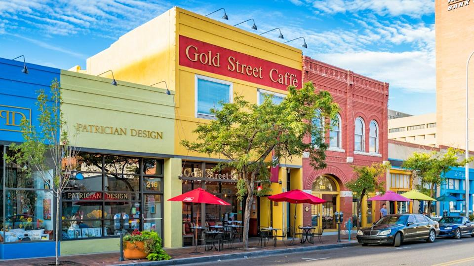 Colorful store facades and cafe in downtown Albuquerque, New Mexico, USA on a sunny day.