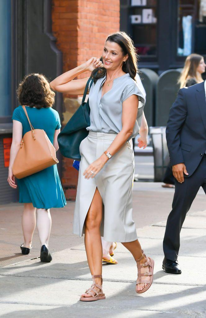 <p>Yep, feel free to double take because that is Natasha... the woman Mr Big left Carrie for to marry and then subsequently cheat on Natasha again with Carrie. </p><p>Natasha opts for a tonal look in 2021, with a silk-look shirt, pencil skirt and gladiator sandals.</p>